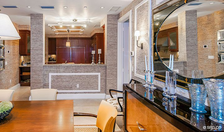 Dining Room and Kitchen in Residence 406 at Bellaria, Luxury Oceanfront Condominiums in Palm Beach, Florida 33480.